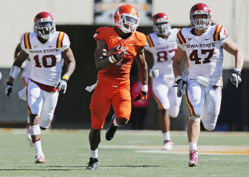 Photo - Oklahoma State's Joseph Randle (1) runs from Iowa State's Jacques Washington (10), David Irving (87) and  A.J. Klein (47) on a 62-yard carry in the fourth quarter during a college football game between Oklahoma State University (OSU) and Iowa State University (ISU) at Boone Pickens Stadium in Stillwater, Okla., Saturday, Oct. 20, 2012. OSU won, 31-10. Photo by Nate Billings, The Oklahoman