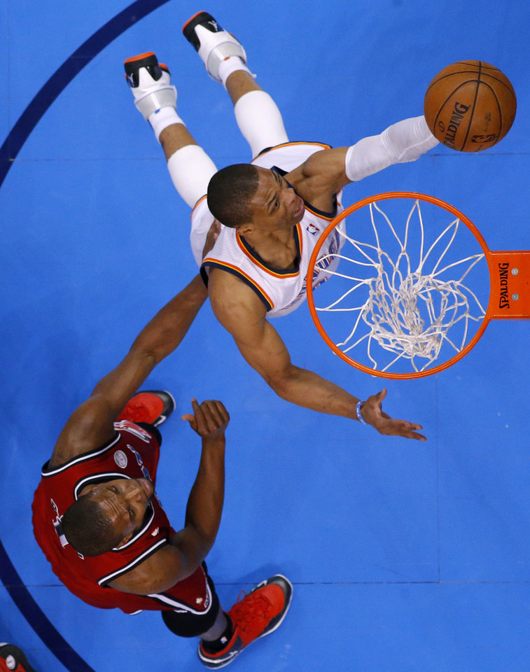 Oklahoma City's Russell Westbrook (0) goes to the basket past Miami's Chris Bosh (1) during an NBA basketball game between the Oklahoma City Thunder and the Miami Heat at Chesapeake Energy Arena in Oklahoma City, Thursday, Feb. 15, 2013. Miami won 110-100. Photo by Bryan Terry, The Oklahoman