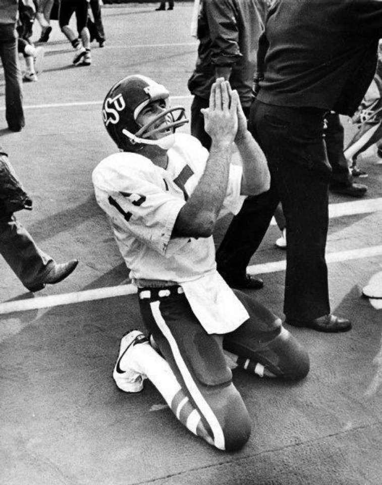 """UNIVERSITY OF OKLAHOMA, OKLAHOMA STATE UNIVERSITY, BEDLAM, COLLEGE FOOTBALL, 1976: """"Thankful Charlie Weatherbie, OSU quarterback who came in to lead his team to victory (over OU), spends a personal moment on the sidelines in Norman after the outcome was assured."""" Staff photo by Bob Albright taken 10/23/76; photo ran in the 10/24/76 Daily Oklahoman.  Photo also ran in the 11/1/88 and 11/12/93 Daily Oklahomans."""