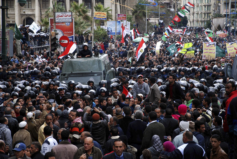 A cordon of riot police separates opponents of Egyptian President Mohammed Morsi and Islamist supporters of the president in Alexandria, Egypt, Friday, Dec. 21, 2012. Thousands of Islamists clashed with their opponents Friday in Egypt\'s second largest city, Alexandria, on the eve of the second leg of voting on the country\'s contentious constitution that has deeply polarized the nation.(AP Photo/Ahmed Ramadan)