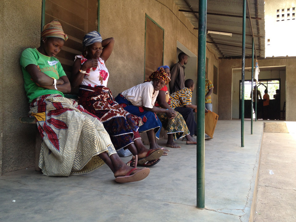 Patients who are isolated from Ivory Coast's major cities wait in line for medical care outside a cinderblock hospital in Doropo, Ivory Coast, that a medical team from Norman humanitarian group 1040i used in the last couple of weeks to help them. PHOTO PROVIDED. <strong></strong>