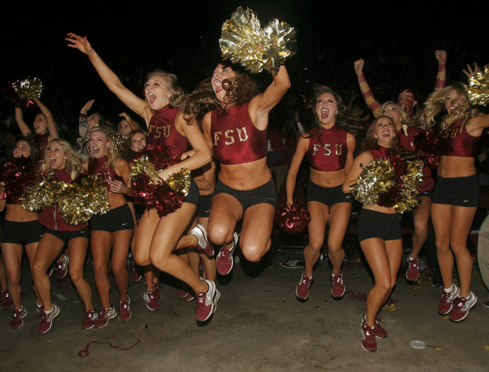 Photo - Florida State Golden Girls cheerleaders react as they watch a touchdown in the final seconds of the BCS Championship football game between Florida State and Auburn on a 30-foot screen at the Tallahassee Leon County Civic Center on Monday, Jan. 6, 2014, in Tallahassee, Fla. Florida State beat Auburn 34-31. (AP Photo/Phil Sears)