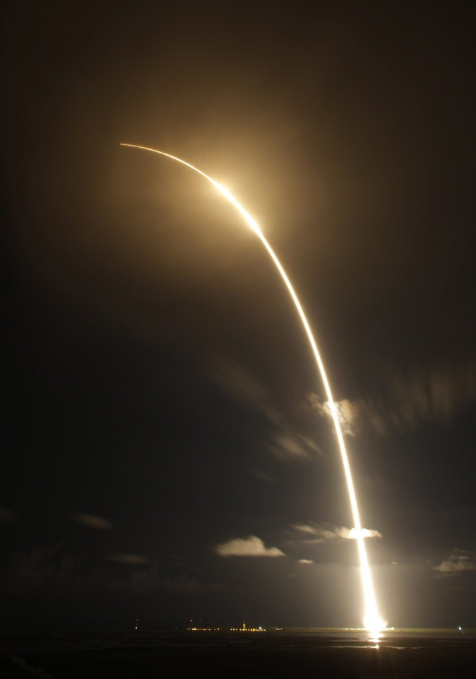 Photo -   The Falcon 9 SpaceX rocket is shown in a time exposure as it lifts off from space launch complex 40 at the Cape Canaveral Air Force Station in Cape Canaveral, Fla. on Sunday, Oct. 7, 2012. The rocket is carrying supplies to the International Space Station. (AP Photo/Terry Renna)