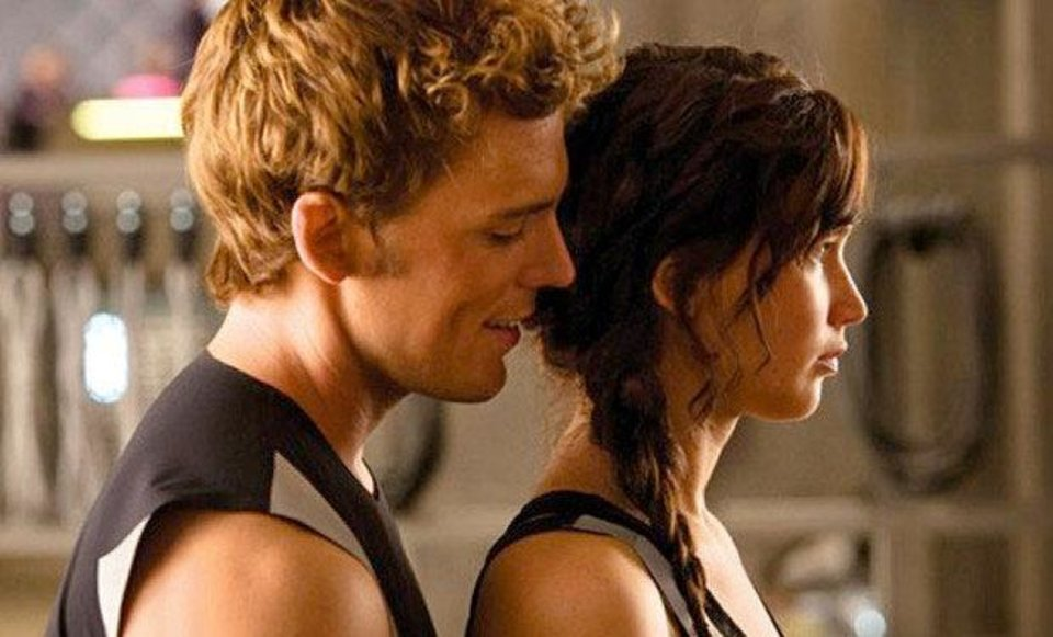 Photo - From left, Sam Claflin plays Finnick Odair and Jennifer Lawrence plays Katniss Everdeen in the sequel