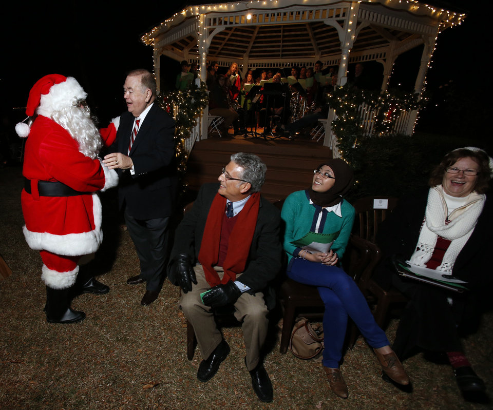 University of Oklahoma President David L. Boren greets Santa Claus at OU\'s holiday lights celebration. PHOTO BY STEVE SISNEY, THE OKLAHOMAN STEVE SISNEY