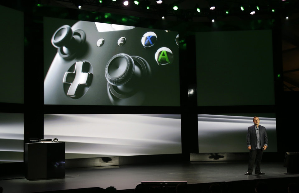 Photo - Marc Whitten, Microsoft Corp.'s chief production officer of interactive entertainment, talks about the controller of the next-generation Xbox One entertainment and gaming console system, Tuesday, May 21, 2013, at an event in Redmond, Wash. (AP Photo/Ted S. Warren)