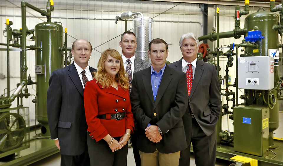 Compressco Partners LP's James Rounsavall, CFO, Sheri Vanhooser, VP of Business Development, Larry Brickman, VP of Field Services, Kenny Sylvester, VP of Production Operations and Ron Foster, President and CEO, pose for a photo in the manufacturing facility in Oklahoma City, Okla., Wednesday, Oct. 17, 2012. Photo by Chris Landsberger, The Oklahoman