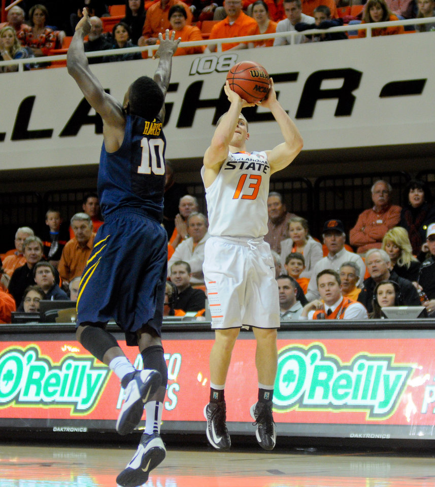 Oklahoma State forward Phil Forte shoots over West Virginia defender Eron Harris during an NCAA college basketball game in Stillwater, Okla., Saturday, Jan. 26, 2013. (AP Photo/Tulsa World, KT King)  ONLINE OUT; TV OUT; TULSA OUT