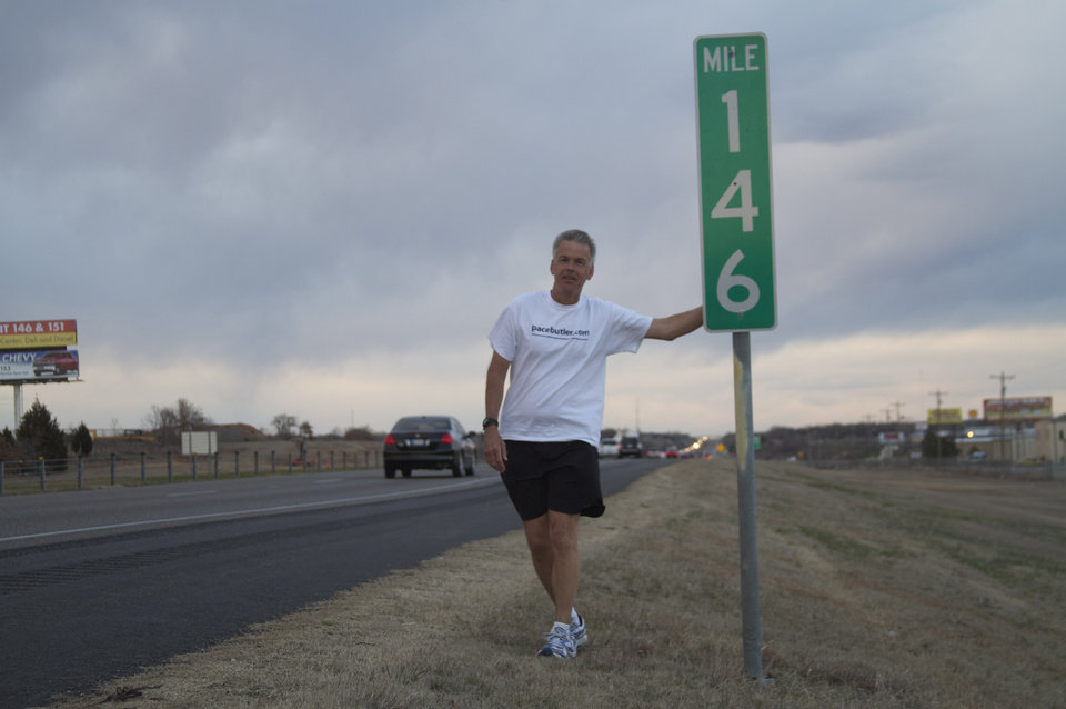 Tom Pace, CEO of PaceButler Corp, pauses for a picture during his run across the state to promote literacy, mentoring and running. Photo provided