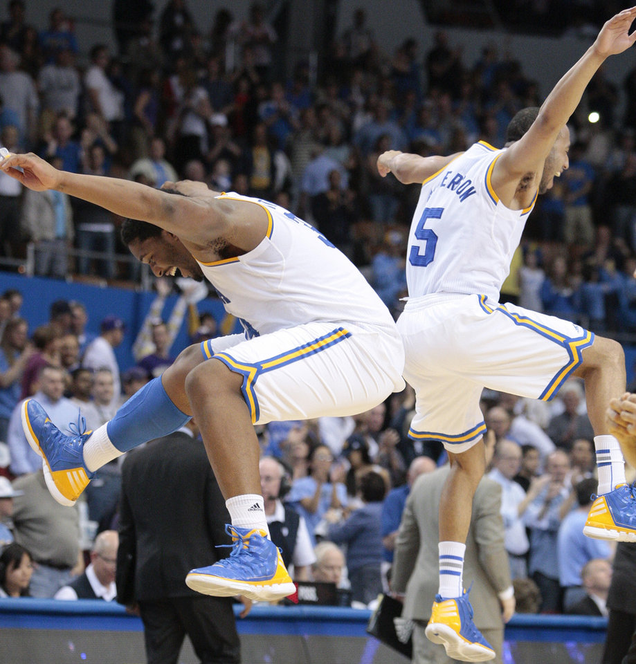 UCLA's Joshua Smith, left, and Jerime Anderson celebrate after beating Washington 75-69 in an NCAA college basketball game, Saturday, March 3, 2012, in Los Angeles. (AP Photo/Jason Redmond)