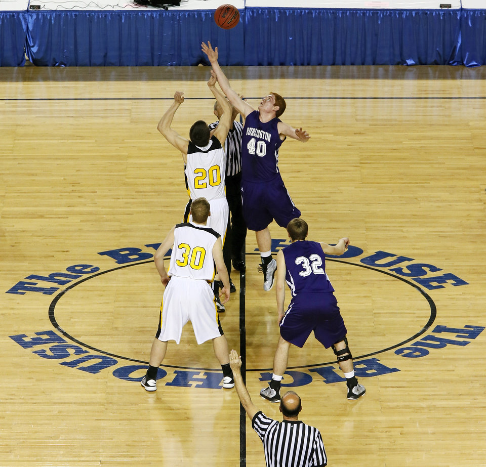 Photo - Arnett's Tyler Tune (20) and Burlington's Brandon Gosselin (40) jump for the opening tip in front of Arnett's Nicolas Smith (30) and Lane Newlin (32) during a Class B Boys first-round game of the state high school basketball tournament between Burlington and Arnett at Jim Norick Arena, The Big House, on State Fair Park in Oklahoma City, Thursday, Feb. 28, 2013. Arnett won, 56-32. Photo by Nate Billings, The Oklahoman