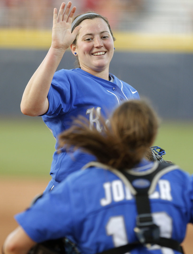 Photo - Kentucky's Kelsey Nunley (33) celebrates after winning a Women's College World Series game between La.-Lafayette and Kentucky at ASA Hall of Fame Stadium in Oklahoma City Thursday, May 29, 2014. Photo by Bryan Terry, The Oklahoman