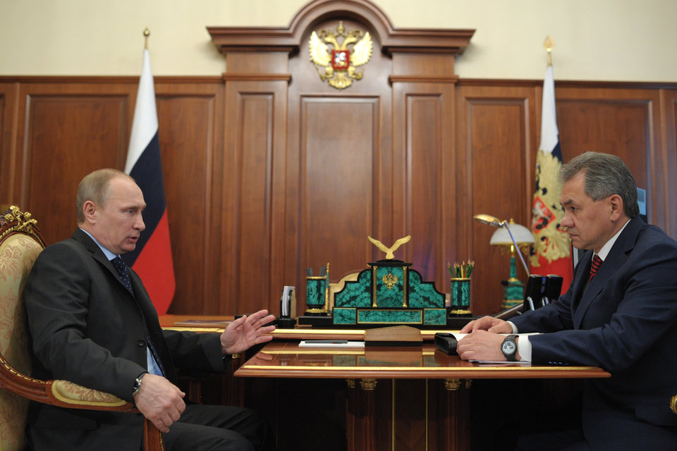 Photo - Russian President Vladimir Putin speaks with Defense Minister Sergei Shoigu, right, during a meeting in Moscow's Kremlin on Thursday, March 20, 2014. Russia faces further sanctions from the European Union on Thursday over its annexation of the Crimean Peninsula as tensions in the region remained high despite the release of a Ukrainian naval commander. (AP Photo/RIA Novosti, Alexei Druzhinin, Presidential Press Service)
