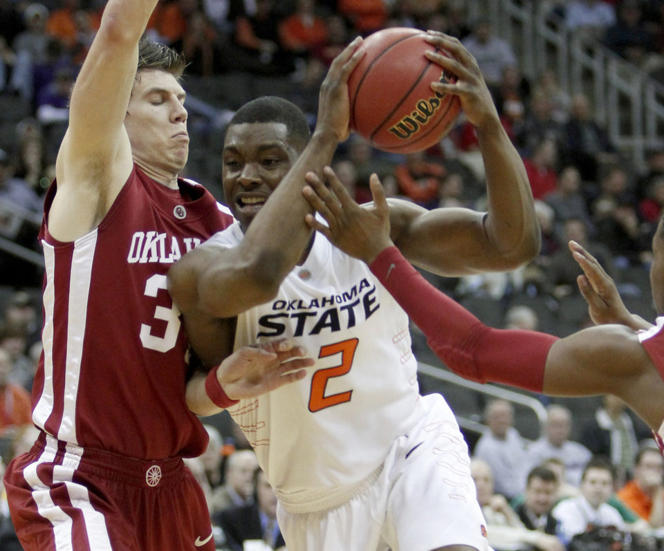 OSU\'s Obi Muonelo drives past OU\'s Cade Davis in the first half of the college basketball game during the men\'s Big 12 Championship tournament at the Sprint Center on Wednesday, March 10, 2010, in Kansas City, Mo. Photo by Bryan Terry, The Oklahoman