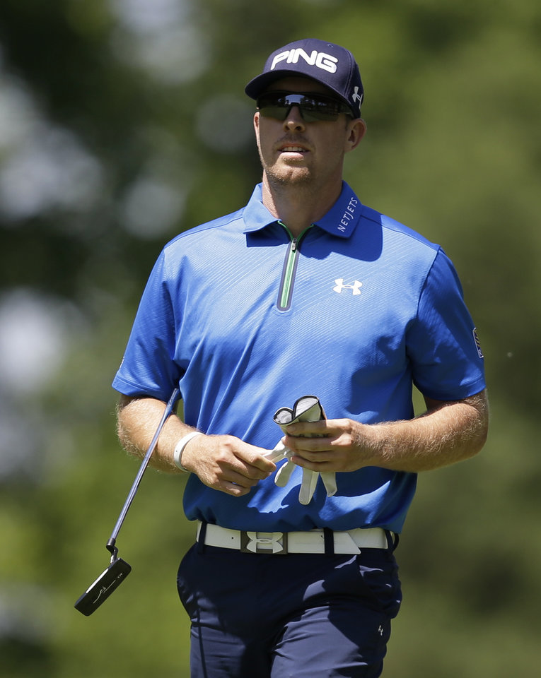 Photo - Hunter Mahan walks to the ninth green during the second round of the Memorial golf tournament Friday, May 30, 2014, in Dublin, Ohio. (AP Photo/Darron Cummings)