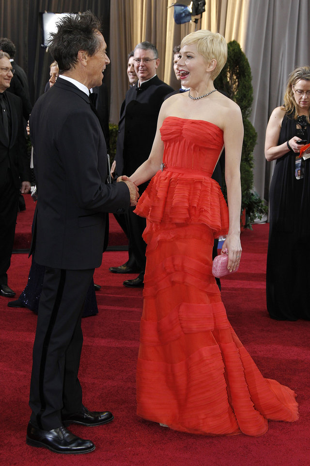 Actress Michelle Williams, right, and producer Brian Grazer speak to each other before the 84th Academy Awards on Sunday, Feb. 26, 2012, in the Hollywood section of Los Angeles. (AP Photo/Amy Sancetta) ORG XMIT: OSC387