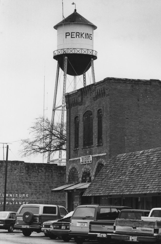 "STREET SCENES / WATER TOWERS:  ""Perkins, Oklahoma.""  Original dated 2/3/1988.  Staff photo by Jim Argo."