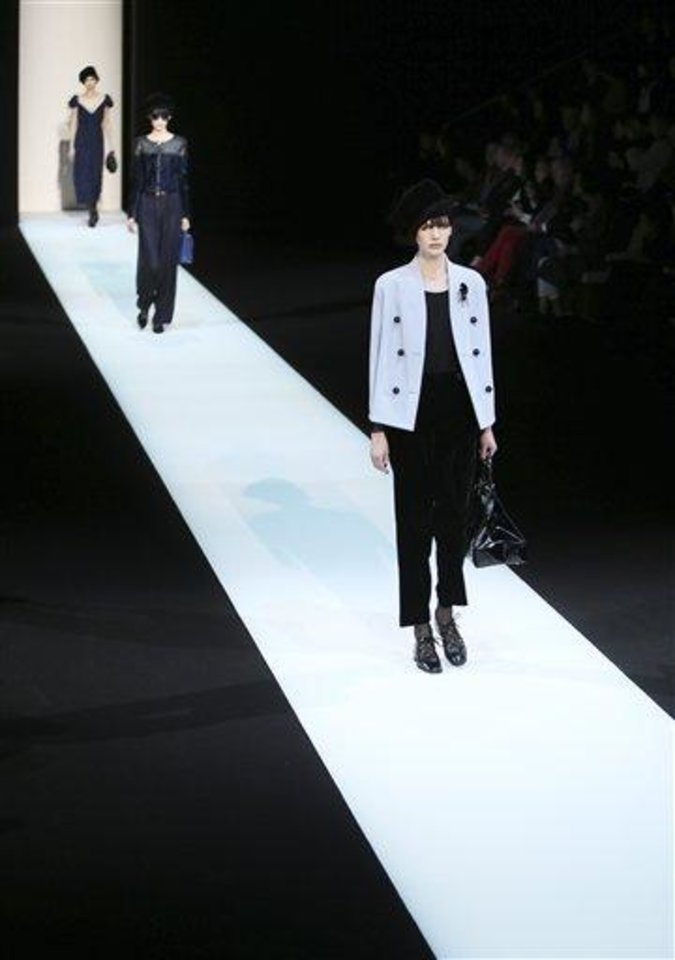 Models wear creations for Giorgio Armani women\'s Fall-Winter 2013-14 collection, part of the Milan Fashion Week, unveiled in Milan, Italy, Monday, Feb. 25, 2013. (AP Photo/Antonio Calanni)