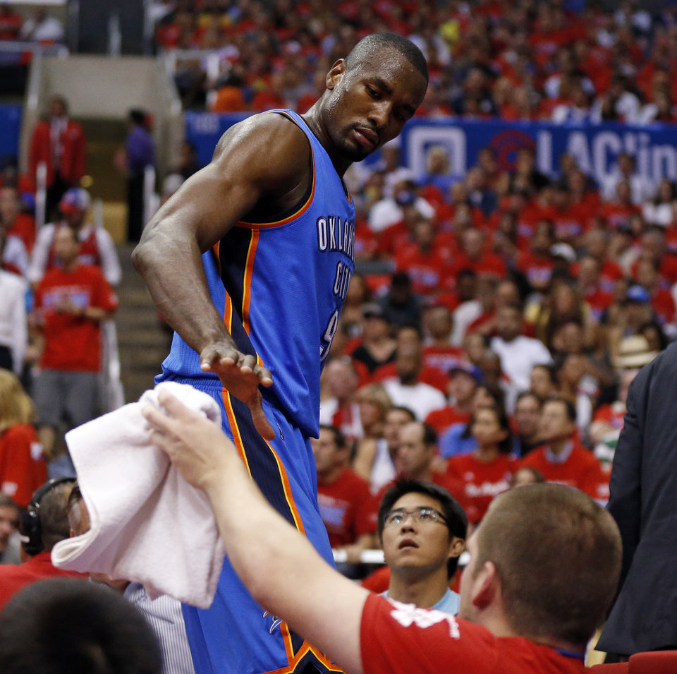 Photo - Oklahoma City's Serge Ibaka (9) leaves the floor in the second half during Game 6 of the Western Conference semifinals in the NBA playoffs between the Oklahoma City Thunder and the Los Angeles Clippers at the Staples Center in Los Angeles, Thursday, May 15, 2014. Photo by Nate Billings, The Oklahoman