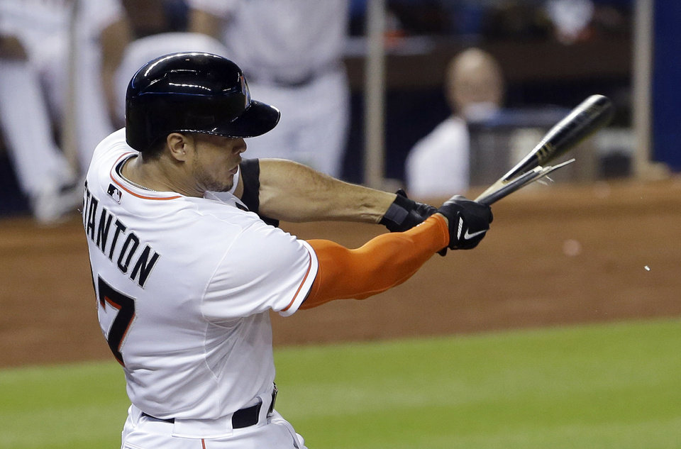 Photo - Miami Marlins' Giancarlo Stanton breaks his bat as he hits during the third inning of a baseball game against the Los Angeles Dodgers, Saturday, May 3, 2014, in Miami. (AP Photo/Wilfredo Lee)
