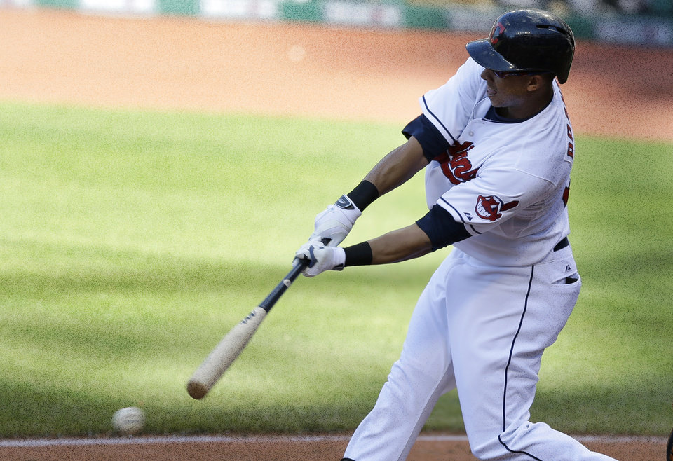 Photo - Cleveland Indians' Michael Brantley hits a two-RBI single off Arizona Diamondbacks starting pitcher Vidal Nuno in the sixth inning of the first baseball game of a doubleheader, Wednesday, Aug. 13, 2014, in Cleveland. Zach Walters and Jason Kipnis scored on the play. (AP Photo/Tony Dejak)