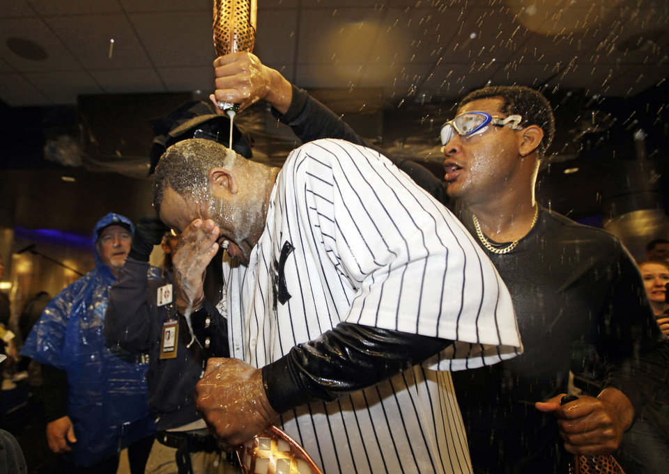 Photo -   New York Yankees starting pitcher CC Sabathia is doused with champagne by teammate Ivan Nova, right, after Game 5 of the American League division baseball series against the Baltimore Orioles Friday, Oct. 12, 2012, in New York. The Yankees won the game 3-1 and advanced to the AL championship. (AP Photo/Kathy Willens)