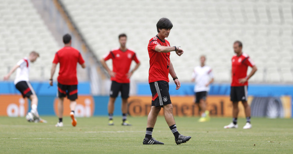 Photo - German national soccer team head coach Joachim Loew checks the time during an official training session the day before the group G World Cup soccer match between Germany and Ghana at the Arena Castelao in Fortaleza, Brazil, Friday, June 20, 2014. (AP Photo/Matthias Schrader)