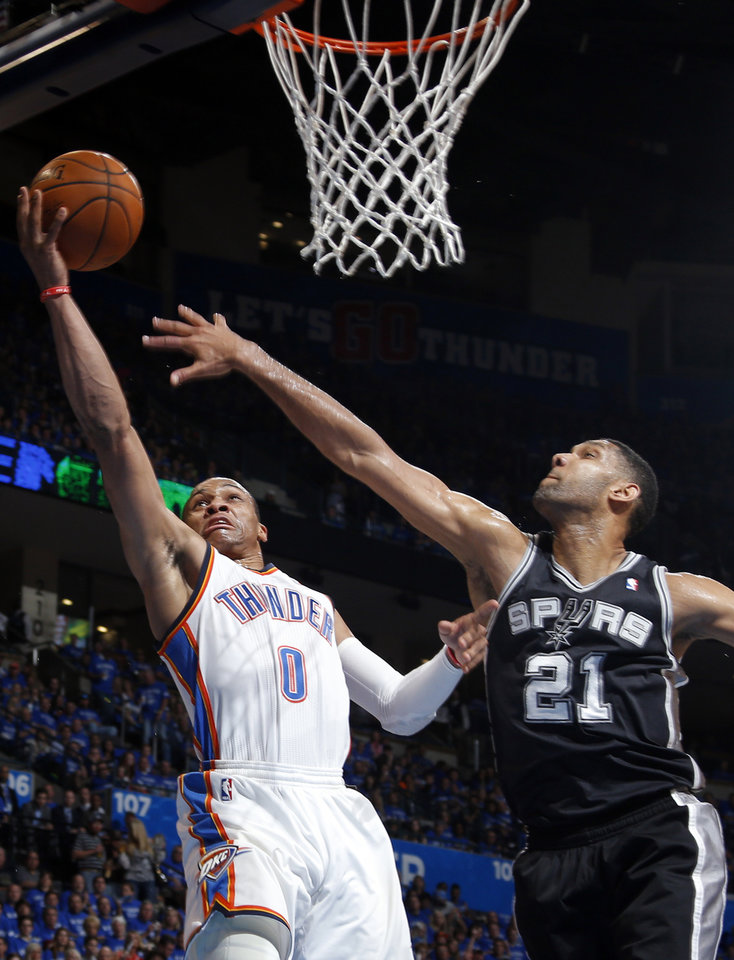 Photo - Oklahoma City's Russell Westbrook (0) shoots a lay up as San Antonio's Tim Duncan (21) defends during Game 3 of the Western Conference Finals in the NBA playoffs between the Oklahoma City Thunder and the San Antonio Spurs at Chesapeake Energy Arena in Oklahoma City, Sunday, May 25, 2014. Photo by Bryan Terry, The Oklahoman