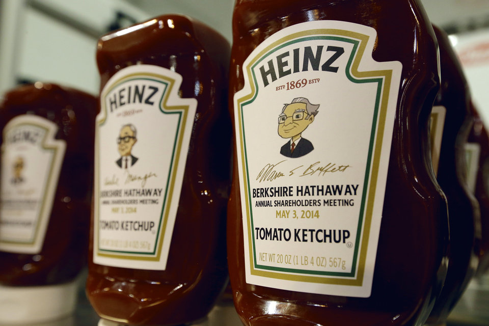 Photo - Heinz commemorative Ketchup bottles bear the cartoon likeness of investor Warren Buffett, right, and of his second in command Charlie Munger, left, at a Heinz display in Omaha, Neb., Friday, May 2, 2014,  one day before the Berkshire Hathaway annual shareholders meeting which takes place on Saturday. (AP Photo/Nati Harnik)