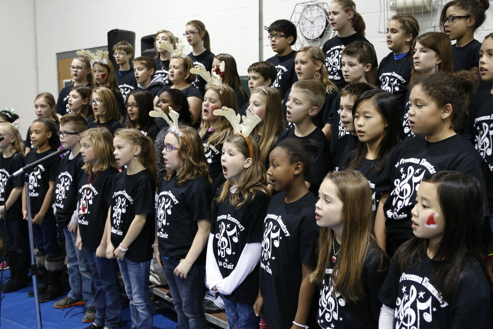 Photo - The Ida Freeman Elementary School honor choir sings during the campus Winterfest.  Photo by Paul Hellstern, The Oklahoman  PAUL HELLSTERN - Oklahoman