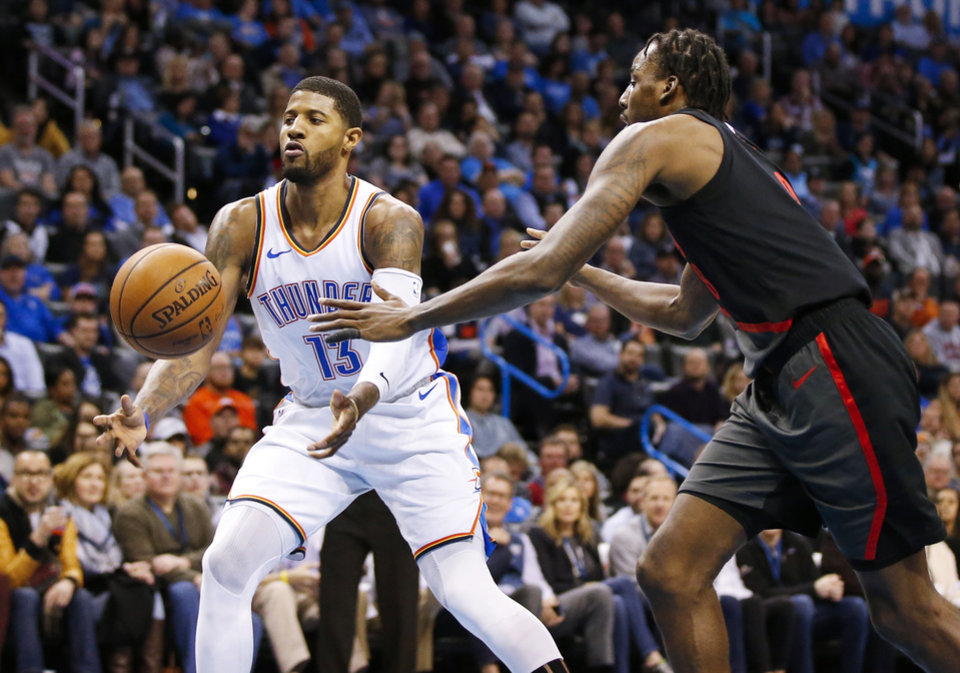 Photo - Oklahoma City's Paul George (13) passes next to Portland's Al-Farouq Aminu (8) in the third quarter during an NBA basketball game between the Portland Trail Blazers and the Oklahoma City Thunder at Chesapeake Energy Arena in Oklahoma City, Monday, Feb. 11, 2019. Oklahoma City won 120-111. Photo by Nate Billings, The Oklahoman