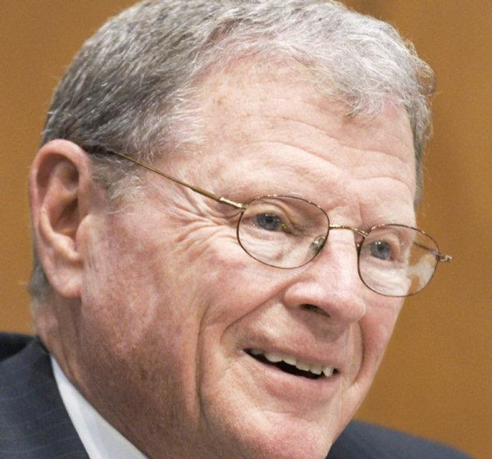 Photo - FILE - In this April 12, 2011 file photo, Sen. James Inhofe, R-Okla. is seen on Capitol Hill in Washington. Some members of Congress are making appointments at CIA headquarters to view graphic photos of Osama bin Laden's corpse. But the American people might have to wait decades to see images of the al-Qaida leader who was killed in Pakistan by Navy SEALs during a daring middle-of-the-night raid. The CIA is allowing members of the House and Senate Intelligence and Armed Services committees to see the photos in a secure room at the agency's headquarters in Langley, Va., a CIA spokeswoman said Wednesday. Lawmakers cannot take copies of the photos with them. (AP Photo/Susan Walsh, File) ORG XMIT: WX303
