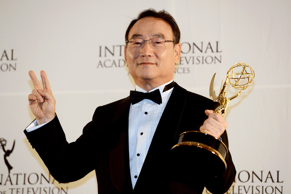 Photo -   Dr. Kim In-Kyu, the president and CEO of the Korean Broadcasting System, poses after winning the Directorate Award at the 40th International Emmy Awards, Monday, Nov. 19, 2012 in New York. (AP Photo/Henny Ray Abrams)