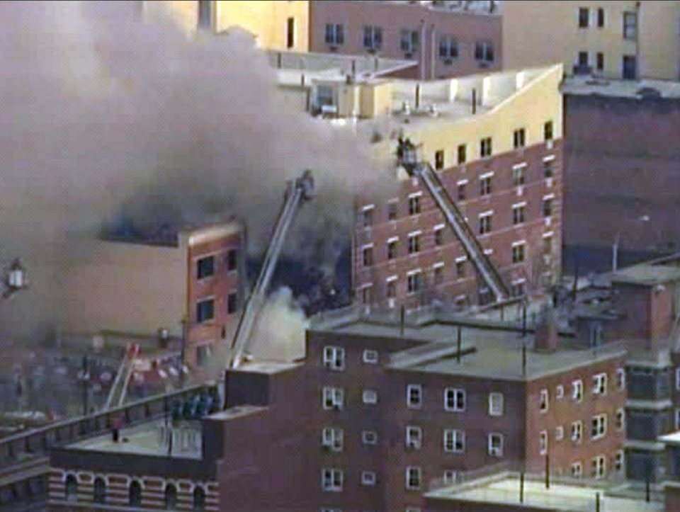 Photo - In this image taken from video from WABC, firefighters battle a blaze at the site of a possible explosion and building collapse in the East Harlem neighborhood of New York, Wednesday, March 12, 2014. (AP Photo/WABC-TV)