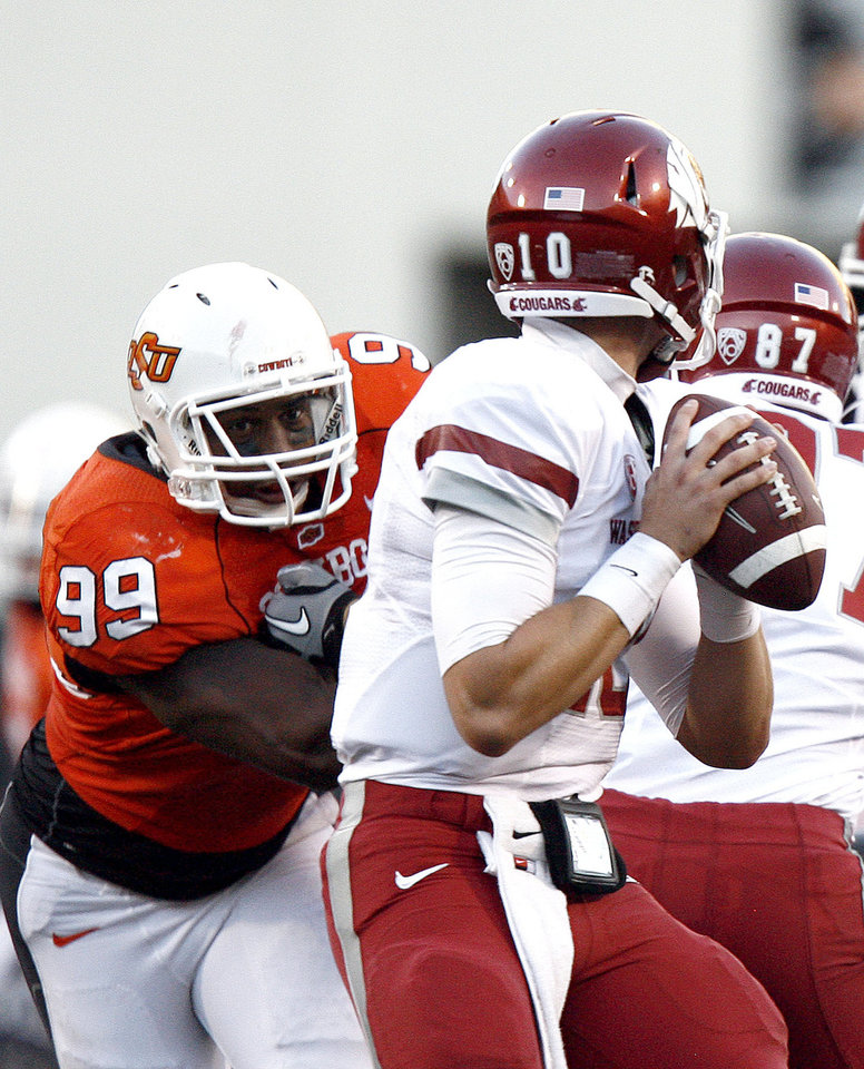 Photo - OSU's Richetti Jones (99) pressures WSu's quarterback Jeff Tuel (10) during the college football game between the Washington State Cougars (WSU) and the Oklahoma State Cowboys (OSU) at Boone Pickens Stadium in Stillwater, Okla., Saturday, September 4, 2010. Photo by Sarah Phipps, The Oklahoman