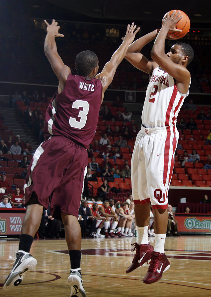 Photo - OU's Steven Pledger (2) shoots over Kevin White (3) of Maryland Eastern Shore during the men's college basketball game between Maryland Eastern Shore and Oklahoma at Lloyd Noble Center in Norman, Okla., Monday, January 3, 2011. Photo by Nate Billings, The Oklahoman