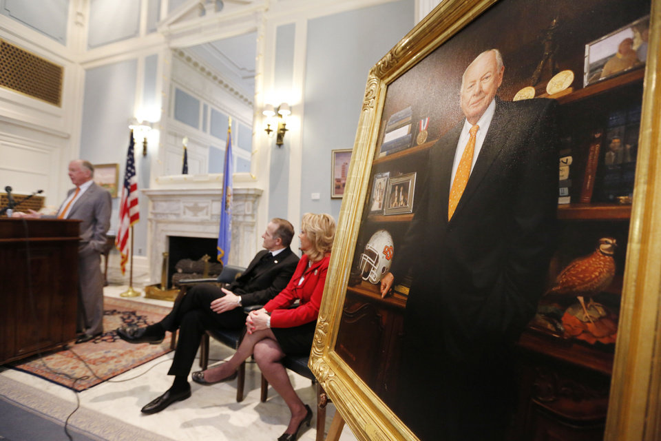 Photo - T. Boone Pickens speaks Thursday during an unveiling ceremony of his portrait at the state Capitol in Oklahoma City. Seated are Oklahoma artist Mike Wimmer and Gov. Mary Fallin. Photo By Steve Gooch, The Oklahoman
