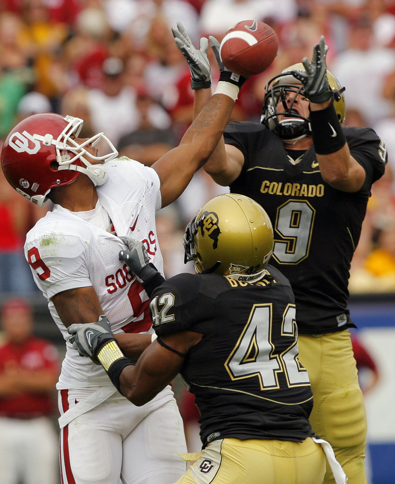 Colorado's Daniel Dykes (9) pulls in an interception on a pass to Oklahoma's Juaquin Iglesias (9) during the second half of the college football game between the University of Oklahoma Sooners (OU) and the University of Colorado Buffaloes (CU) at Folsom Field on Saturday, Sept. 28, 2007, in Boulder, Co. The play led to a touchdown the tied the game for Colorado.