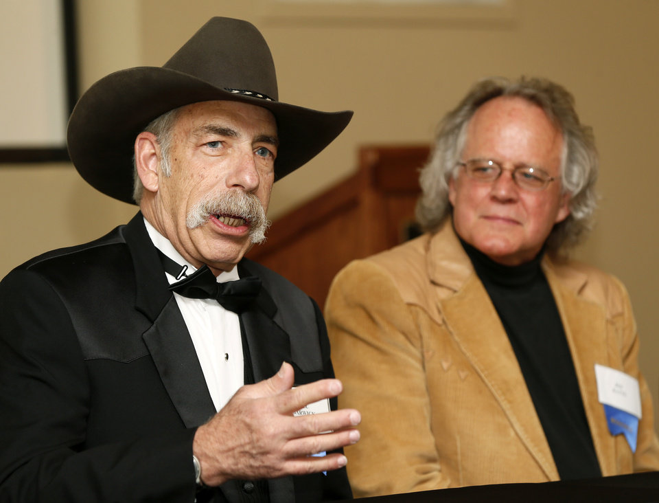 "Producer Jim Ratts, right, watches musician Bill Barwick talk about their album ""The Usual Suspects"" during the press conference before the Western Heritage Awards at the National Cowboy & Western Heritage Museum in Oklahoma City, Saturday, April 20, 2013. ""The Usual Suspects"" is this year's winner of Traditional Western Album. Photo by Nate Billings, The Oklahoman"