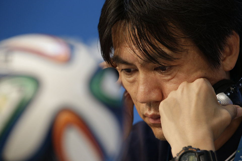 Photo - South Korea national soccer team coach Hong Myung-bo listens to reporter's question during a press conference the day before the group H World Cup soccer match between Russia and South Korea at the Arena Pantanal in Cuiaba, Brazil, Monday, June 16, 2014. (AP Photo/Lee Jin-man)
