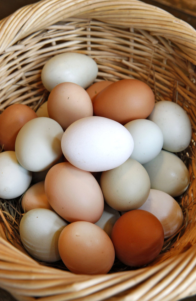 Photo - Kamala Gamble's basket of naturally multicolored eggs, Friday, March 22, 2013. Photo By David McDaniel/The Oklahoman
