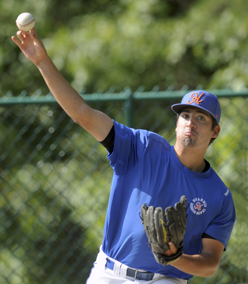 Photo - In this Thursday, July 31, 2014 photo, Hyannis pitcher Ryan Perez, of Hampshire, Ill., pitches with his right hand during warm-ups before a Cape Cod Baseball League game in Cotuit, Mass. The 20-year-old ambidextrous pitcher from tiny Judson University has blossomed into a potential high-round pick for the 2015 draft with his performances this summer in the prestigious Cape Cod League. (AP Photo/Cape Cod Times, Ron Schloerb) MANDATORY CREDIT: CAPE COD TIMES/RON SCHLOERB