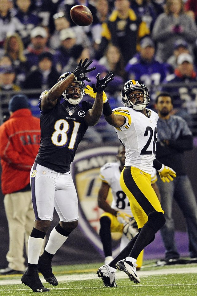 Photo - CORRECTS TO REACHES FOR A PASS NOT A TOUCHDOWN PASS - Baltimore Ravens wide receiver Anquan Boldin (81) reaches for a pass under pressure form Pittsburgh Steelers defensive back Cortez Allen, right, during the first half of an NFL football game in Baltimore, Sunday, Dec. 2, 2012. (AP Photo/Nick Wass)