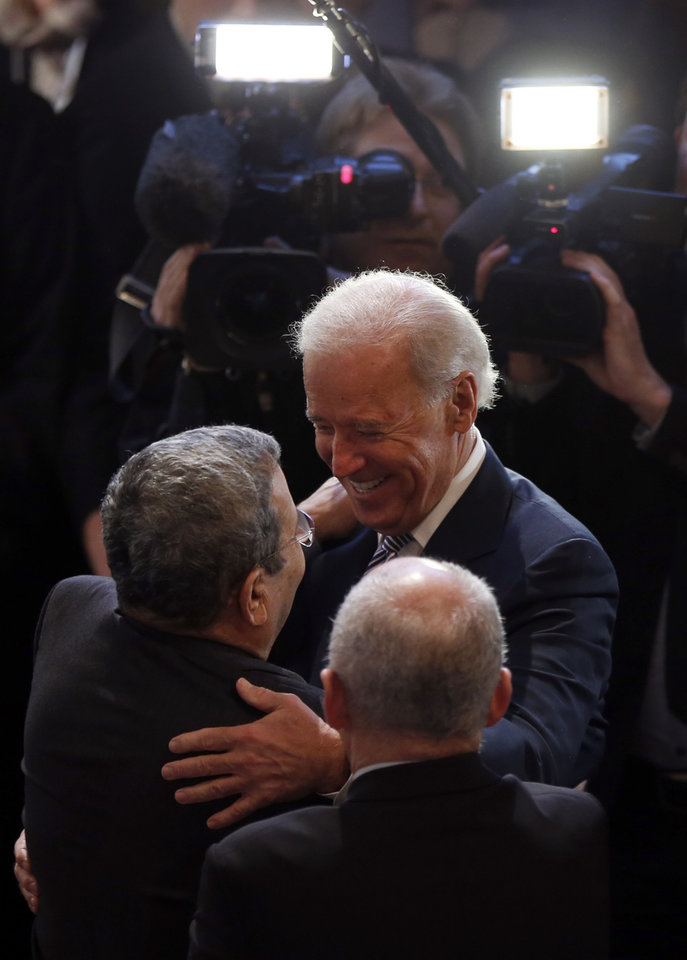 Photo - U.S. Vice President Joe Biden, right, hugs Israeli Defense Minister Ehud Barak as he arrives for the Security Conference in Munich, southern Germany, on Saturday, Feb. 2, 2013. The 49th Munich Security Conference started Friday afternoon with experts from 90 delegations, including Biden. (AP Photo/Matthias Schrader)