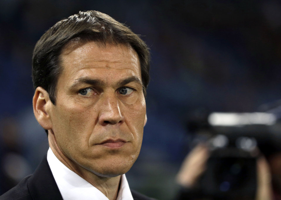 Photo - Roma coach Rudi Garcia waits for the start of  a Serie A soccer match between Roma and Atalanta at Rome's Olympic stadium, Saturday, April 12, 2014. (AP Photo/Gregorio Borgia)