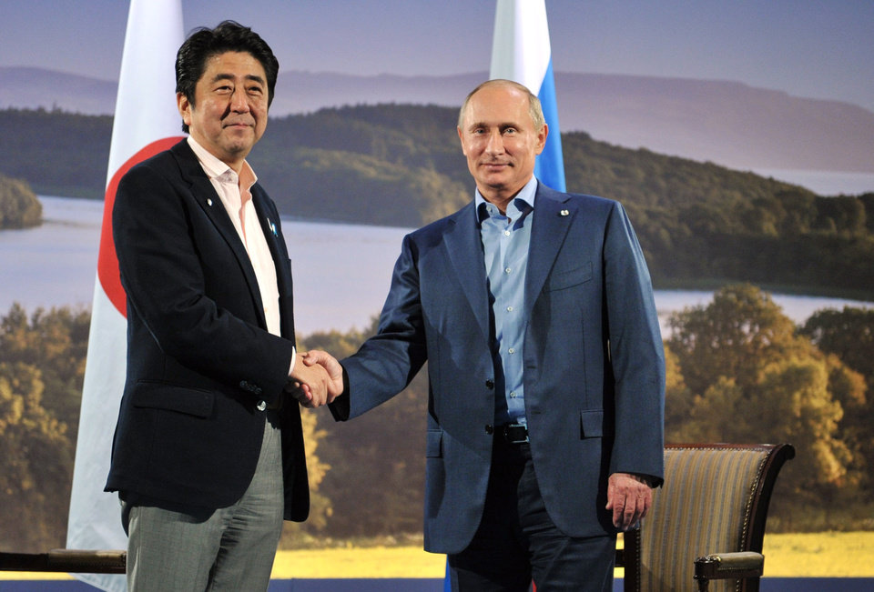 Photo - In this photo taken on Monday, June 17, 2013, Japanese Prime Minister Shinzo Abe, left, and Russian President Vladimir Putin pose for a photo prior their talks in Enniskillen, Northern Ireland. (AP Photo/RIA-Novosti, Alexei Nikolsky, Presidential Press Service, Pool)
