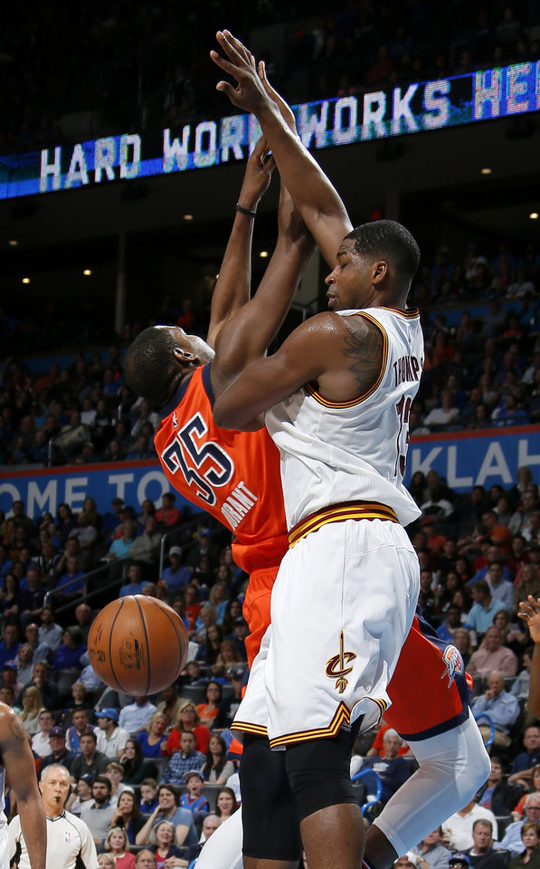 Photo - Oklahoma City's Kevin Durant (35) loses the ball as Cleveland's Tristan Thompson (13) defends during an NBA basketball game between the Oklahoma City Thunder and the Cleveland Cavaliers at Chesapeake Energy Arena in Oklahoma City, Sunday, Feb. 21, 2016. Photo by Bryan Terry, The Oklahoman