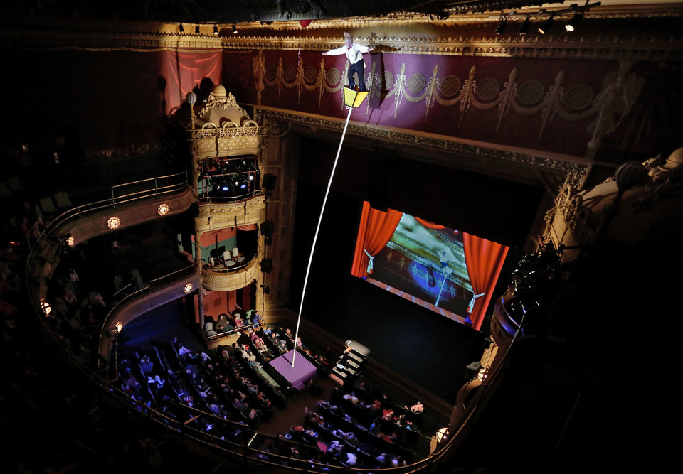 "This March 23, 2013 photo shows performer Bello Nock perched atop a sway pole trying to retrieve an balloon, as he performs during his ""Bello Mania"" show, at the New Victory Theater in New York. Nock, a seventh-generation circus performer, is never offstage during the 90-minute performance, which combines slapstick clowning with death-defying aerial stunts. He performs through March 31 at the New Victory before moving on to the Canadian side of Niagara Falls and then a 10-week stint at the Beau Rivage Casino in Biloxi, Miss.  (AP Photo/Richard Drew)"