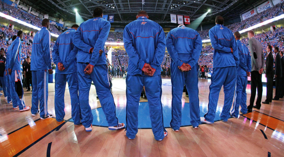 The Oklahoma City Thunder stand during the singing of the national anthem before game 3 of the Western Conference Finals of the NBA basketball playoffs between the Dallas Mavericks and the Oklahoma City Thunder at the OKC Arena in downtown Oklahoma City, Saturday, May 21, 2011. Photo by Nate Billings, The Oklahoman
