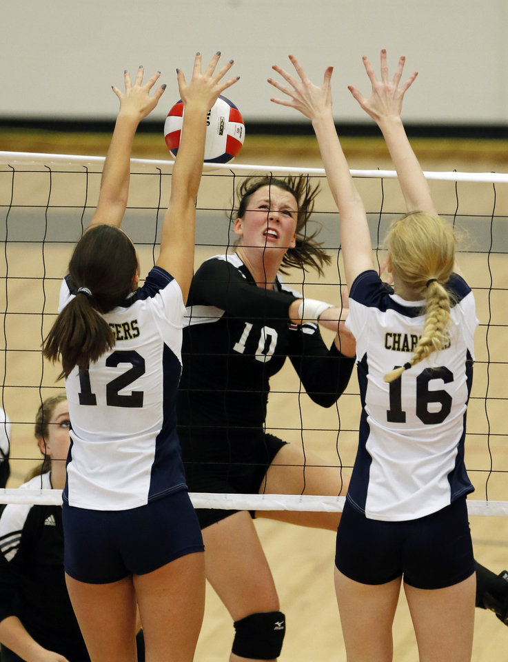 Heritage Hall's Lindsey Grace (12) and Rachel Moore (16) block a return by  Lincoln Christian's Maria Mathews during the Class 5A State Championship volleyball tournament on Friday, Oct. 12, 2012, in Moore, Okla.  Photo by Steve Sisney, The Oklahoman